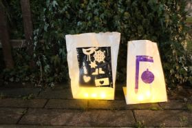Screen printed paper bag lanterns , made by community groups in Ardwick and Hulme (Manchester) .