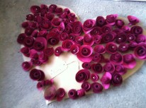 Love heart made from handmade rose corsages.