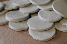 Ceramic discs drying ready for firing to be into International women's day artwork 2014