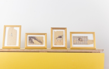 Small envelopes in vintage frames.